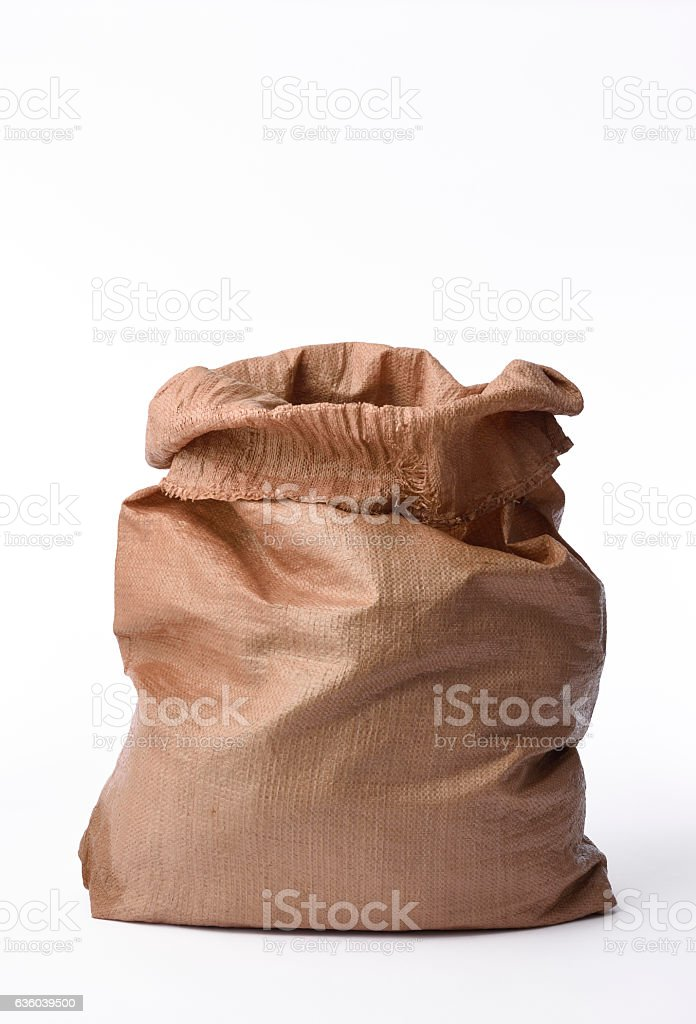 Isolated shot of opened brown garbage bag on white background stock photo
