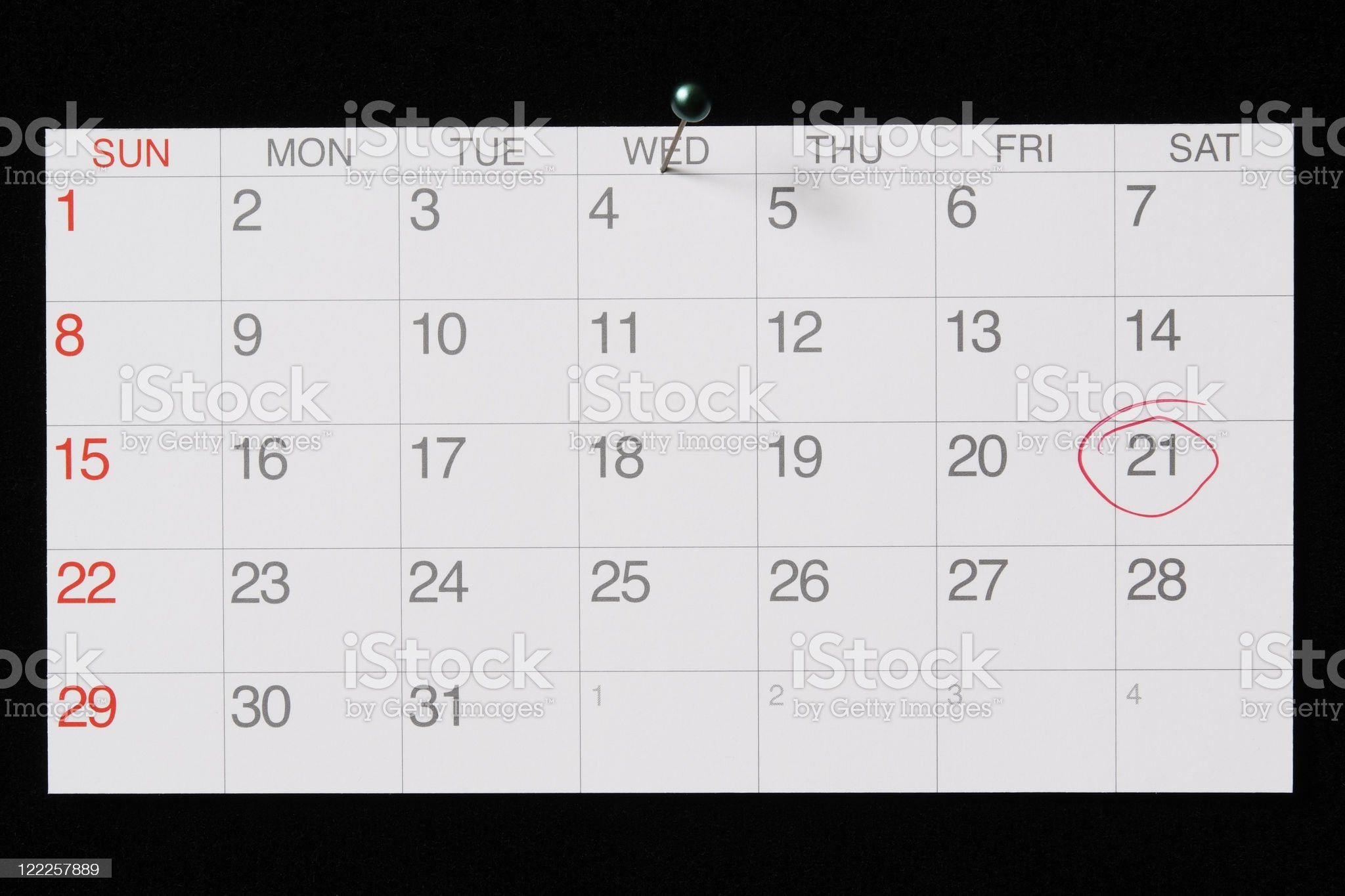 Isolated shot of pinned a calendar on black background royalty-free stock photo