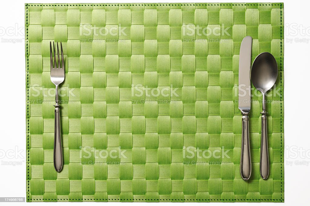 Isolated shot of place mat with silverware on white background royalty-free stock photo