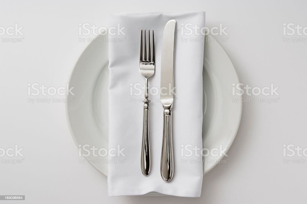 Isolated shot of plate and cutlery on white background royalty-free stock photo