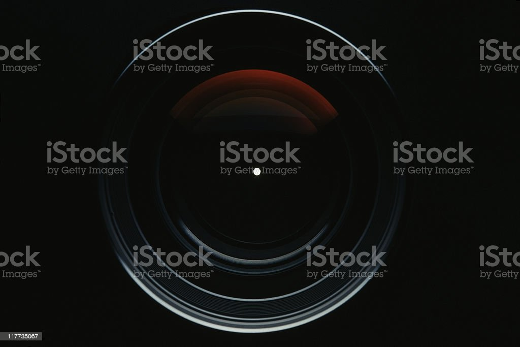 Isolated shot of professional camera lens against black background stock photo