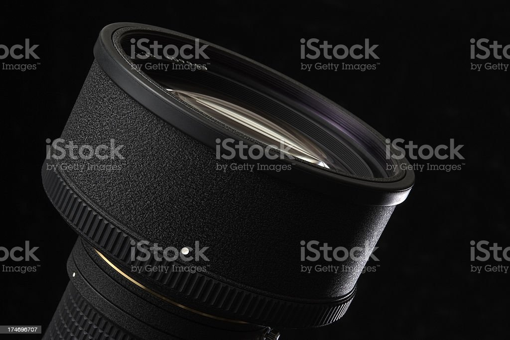 Isolated shot of professional camera lens against black background royalty-free stock photo