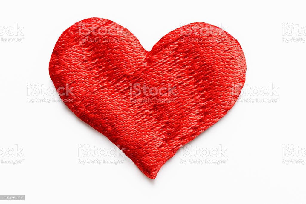Isolated shot of red heart shape embroidery on white background stock photo