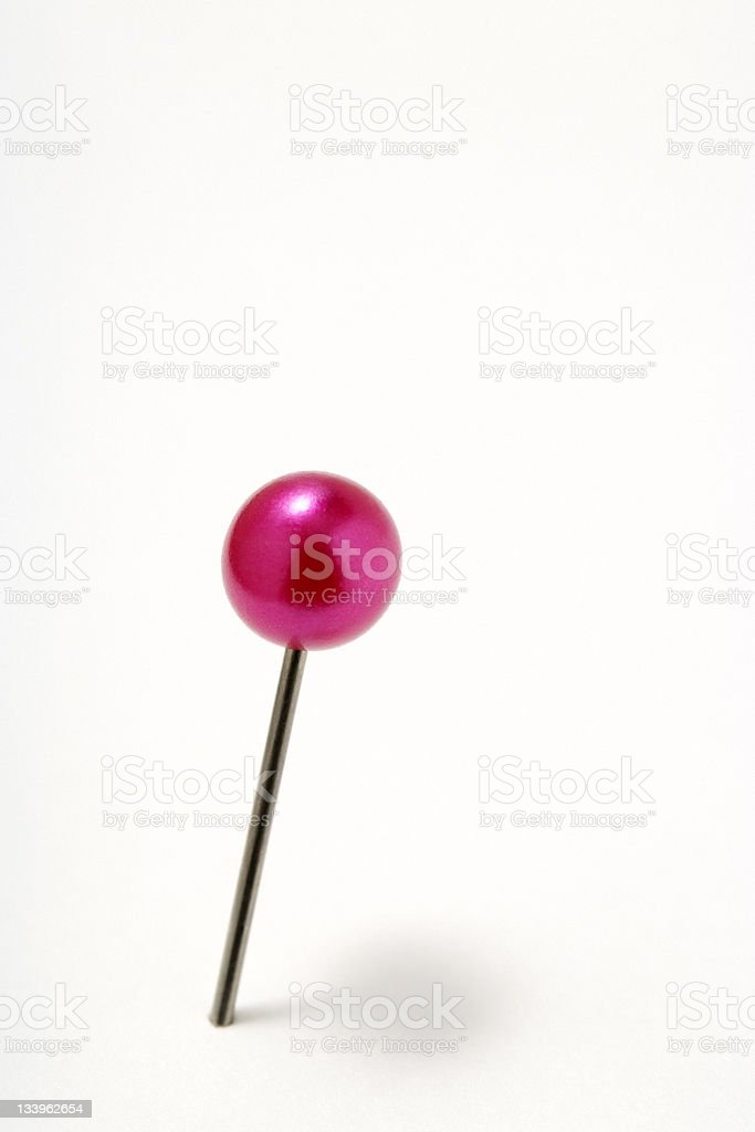 Isolated shot of red pushpin on white background stock photo