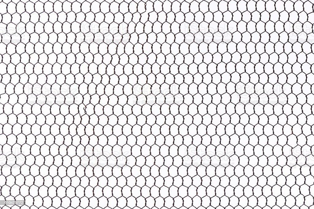 Isolated shot of rusty wire mesh fence on white background stock photo