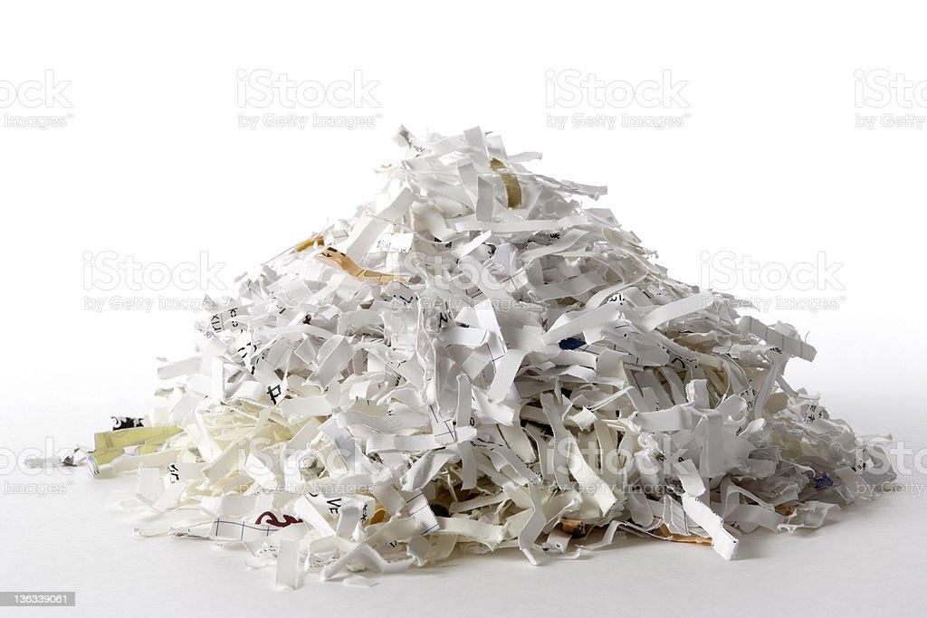 Isolated shot of shredded documents on white background royalty-free stock photo