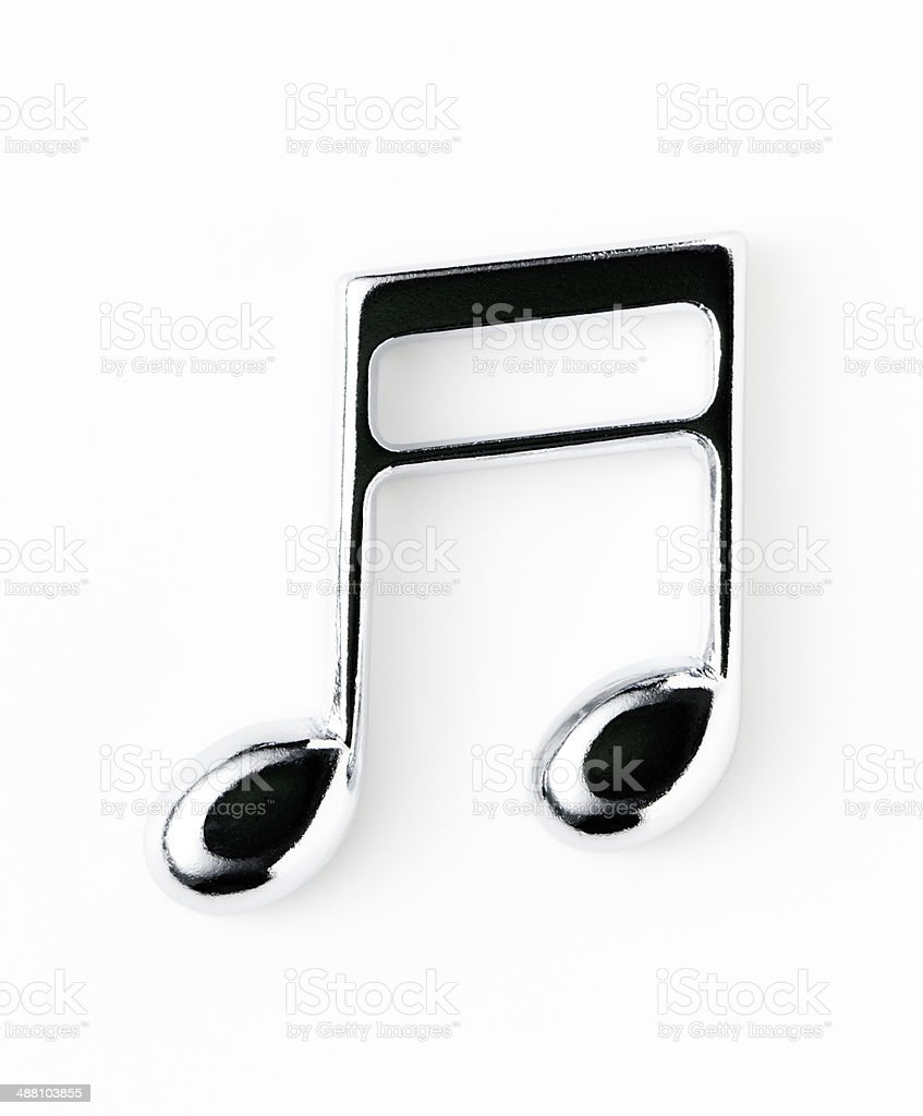 Isolated shot of silver metal musical note on white background royalty-free stock photo
