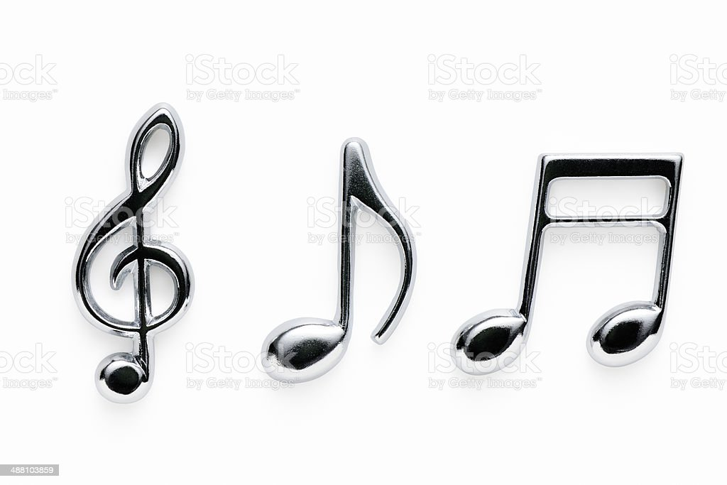 Isolated shot of silver metal musical note on white background stock photo