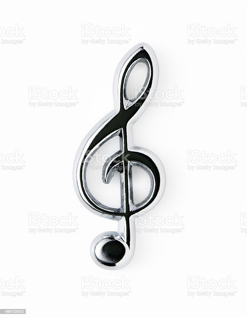 Isolated shot of silver metal treble clef on white background royalty-free stock photo