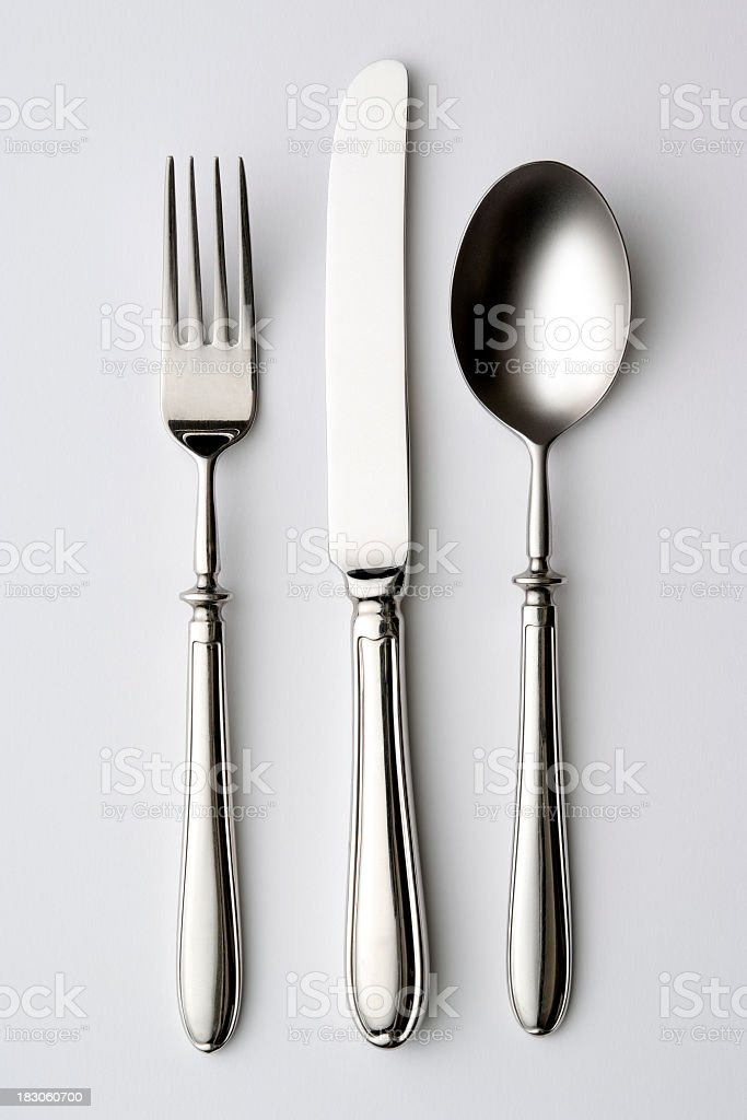 Isolated shot of silverware on white background stock photo
