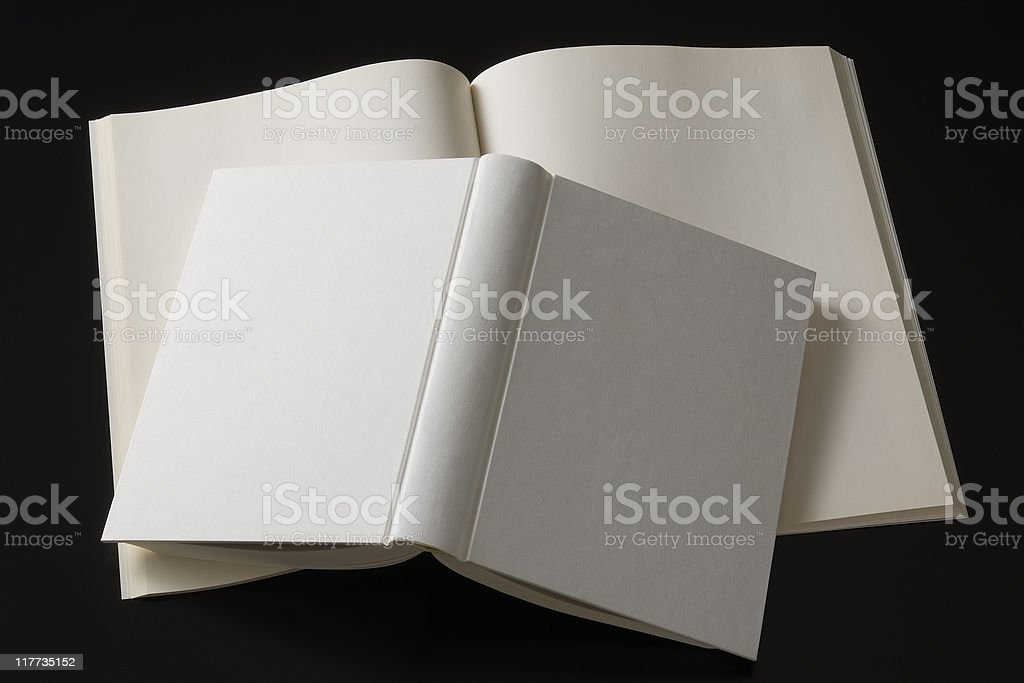 Isolated shot of stacked blank book on black background royalty-free stock photo
