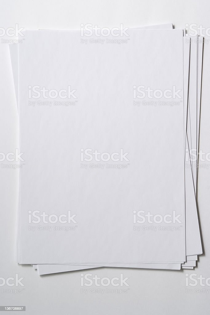 Isolated shot of stacked blank paper on white background royalty-free stock photo