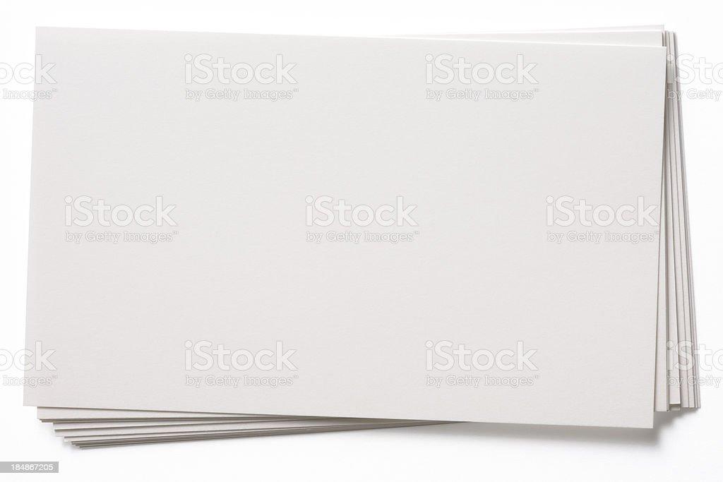 Isolated shot of stacked blank white cards on white background stock photo