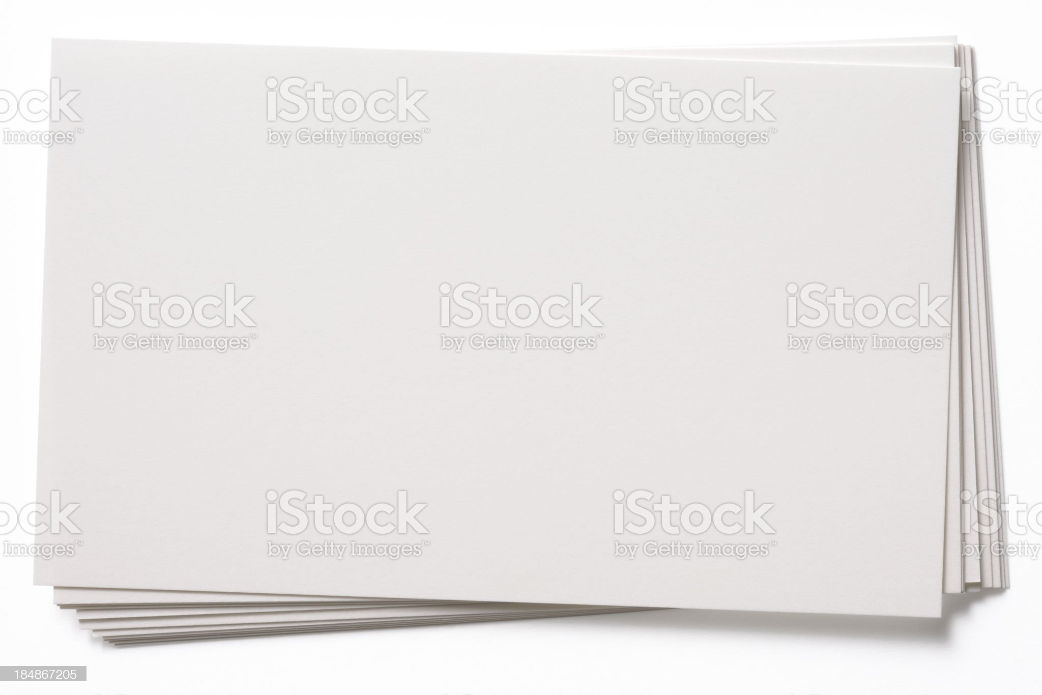 Isolated shot of stacked blank white cards on white background royalty-free stock photo