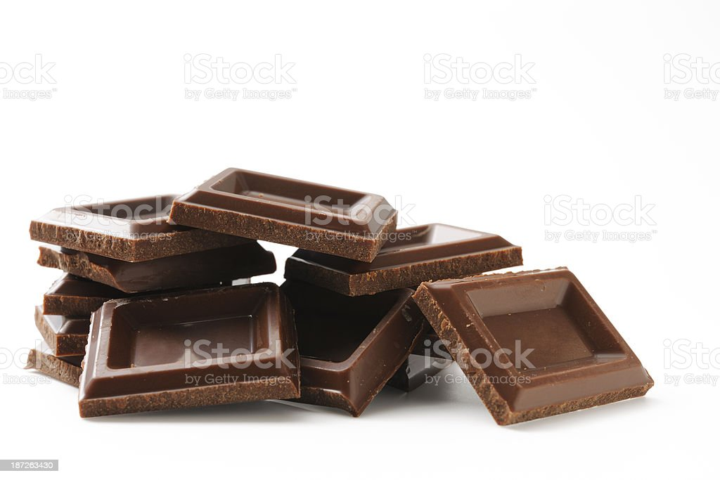 Isolated shot of stacked chocolate bars on white background royalty-free stock photo