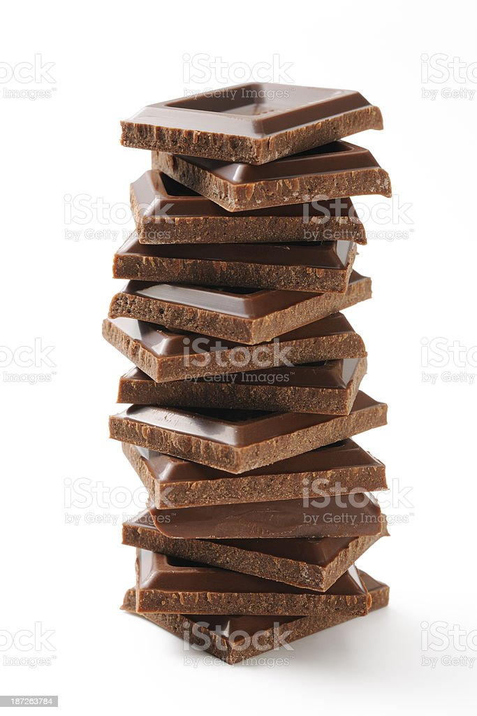 Isolated shot of stacked chocolate bar's tower on white background royalty-free stock photo