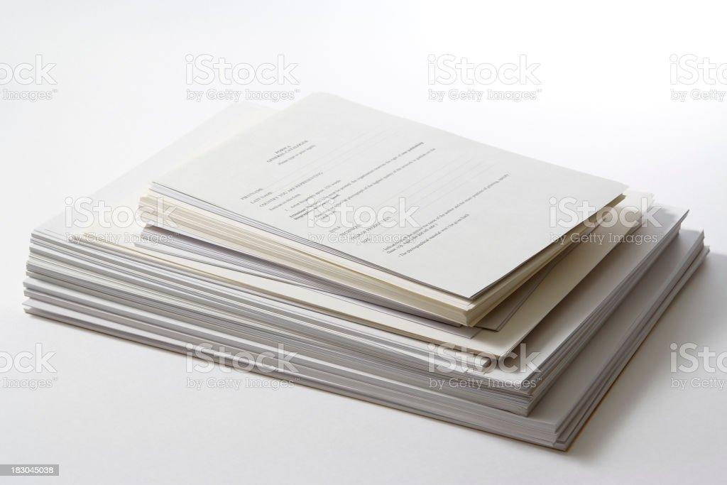 Isolated shot of stacked documents on white background royalty-free stock photo