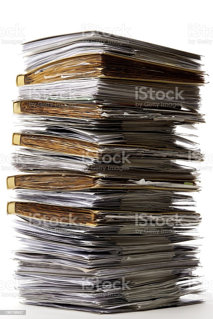 Isolated shot of stacked file folders on white background royalty-free stock photo