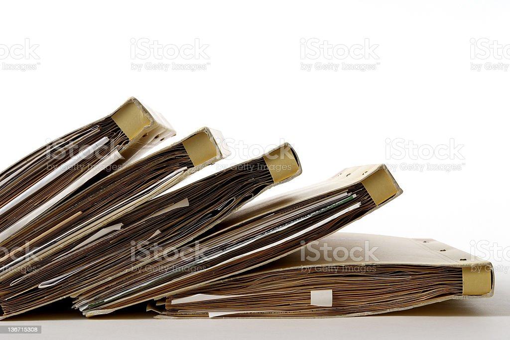 Isolated shot of stacked file folders on white background royalty-free stock photo