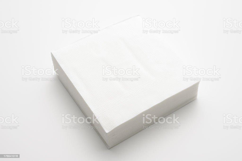 Isolated shot of stacked white paper napkins on white background stock photo