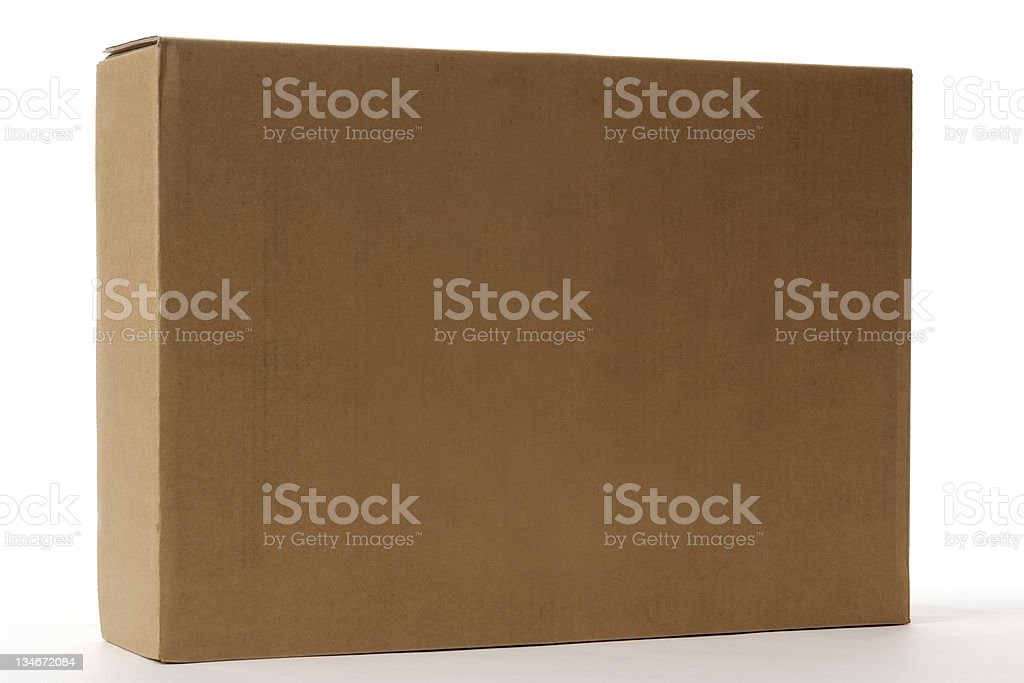 Isolated shot of standing blank cardboard box on white background royalty-free stock photo
