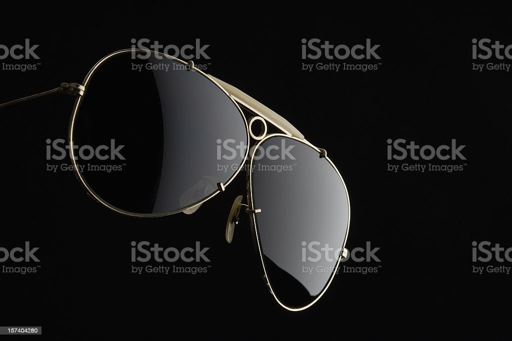 Isolated shot of Sunglasses on black background stock photo