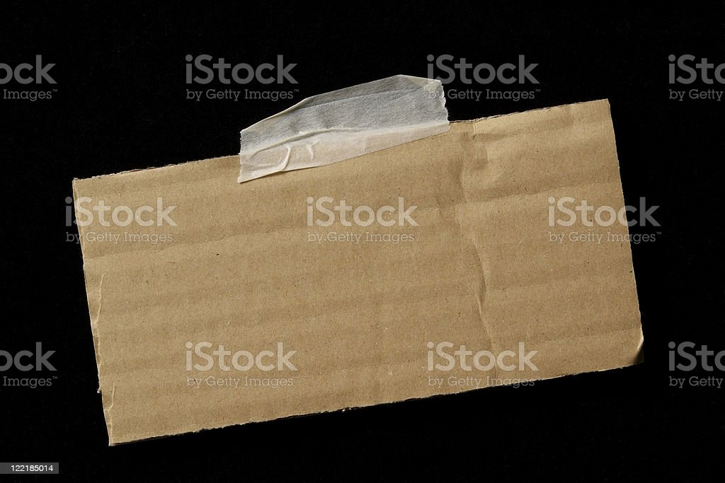 Isolated shot of taped blank cardboard on black background royalty-free stock photo