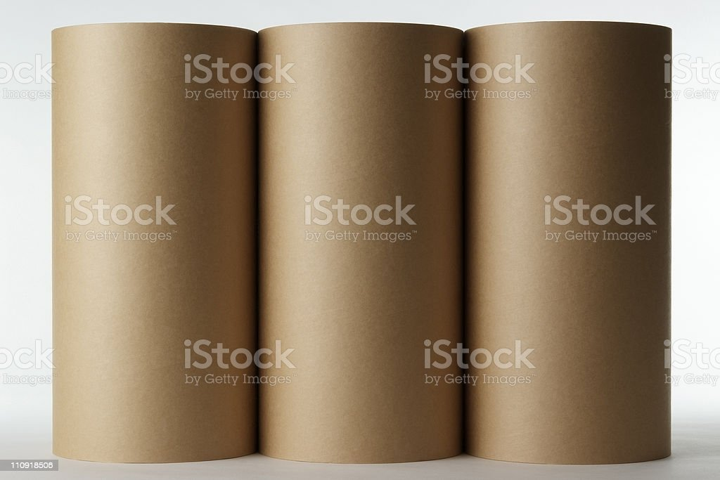 Isolated shot of three blank cardboard cylinder on white background royalty-free stock photo