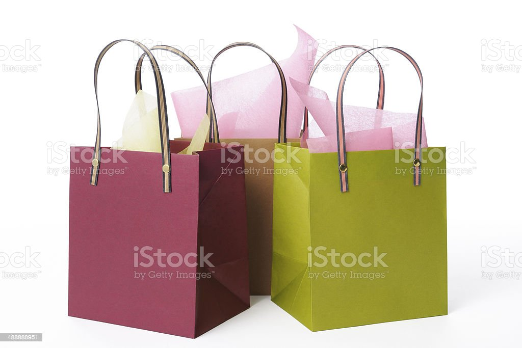 Isolated shot of three colorful shopping bags on white background stock photo