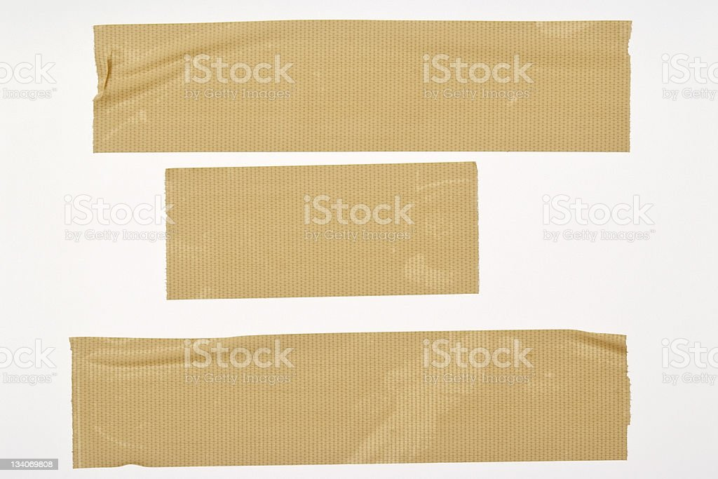 Isolated shot of three torn duct tape on white background royalty-free stock photo