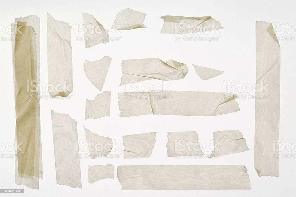 Isolated shot of torn adhesive masking tape on white background stock photo