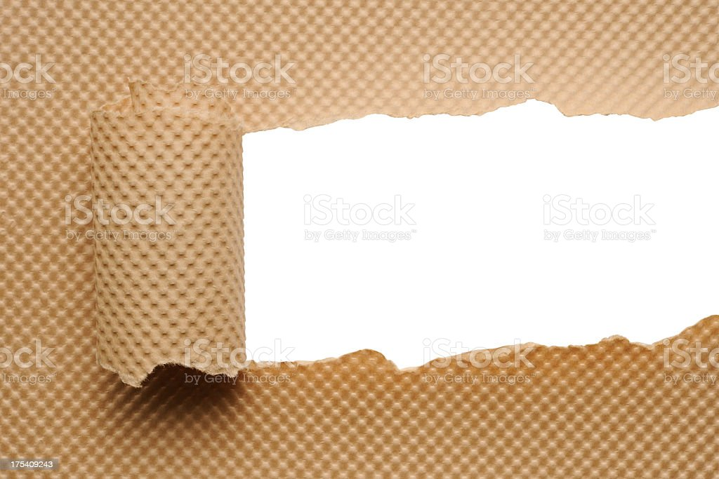 Isolated shot of torn brown wrapping paper against white background royalty-free stock photo