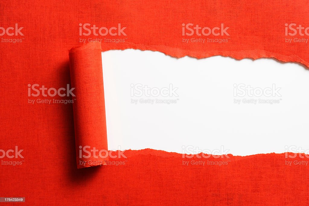 Isolated shot of torn red paper on white background stock photo
