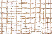 Isolated shot of two beige netting against white background