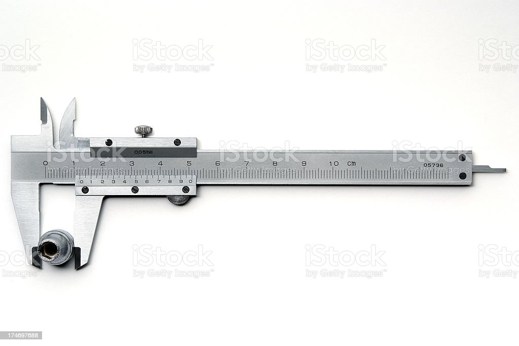 Isolated shot of vernier caliper with box wrench on white royalty-free stock photo