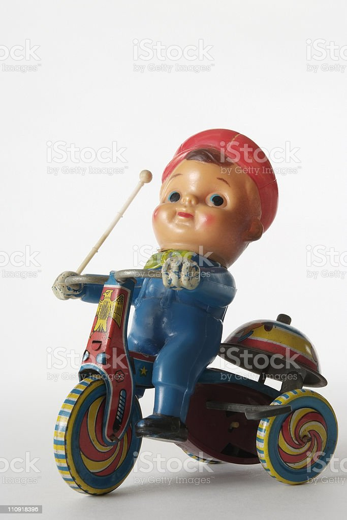 Isolated shot of vintage tin toy rider on white background royalty-free stock photo