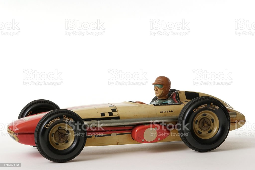 Isolated shot of vintage toy racing car on white background stock photo