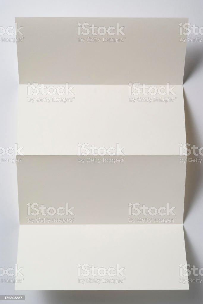Isolated shot of white blank folded paper on white background stock photo