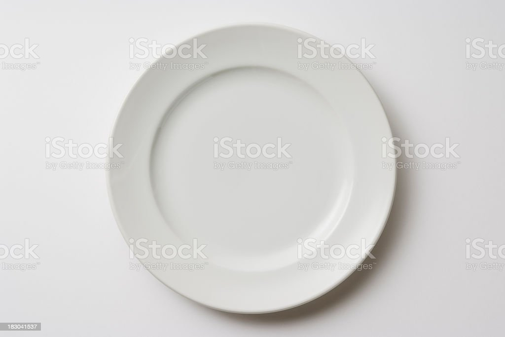 Isolated shot of white plate on white background stock photo