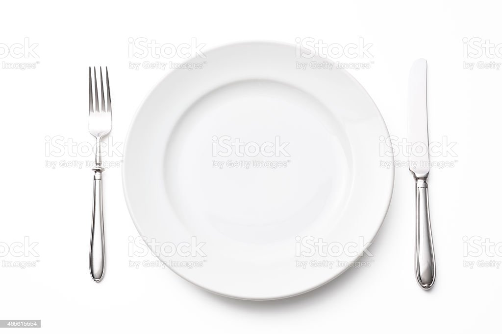 Isolated shot of white plate with silverware on white background stock photo