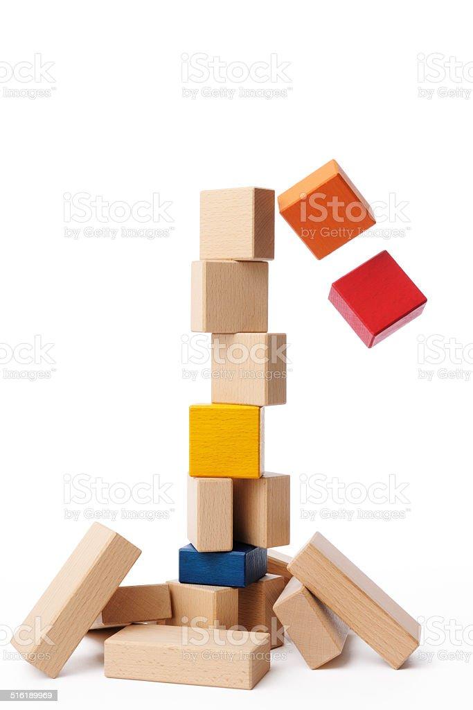 Isolated shot of wood block falling down on white background stock photo