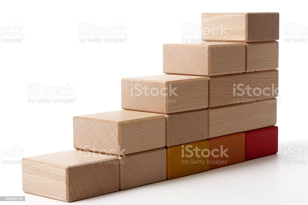 Isolated shot of wood block stairs on white background royalty-free stock photo