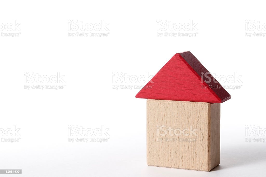 Isolated shot of wooden block house on white background stock photo