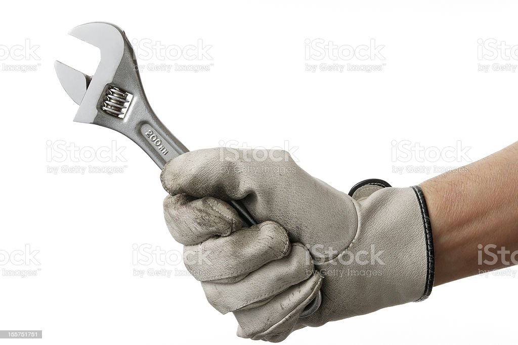 Isolated shot of working hand with wrench against white background stock photo