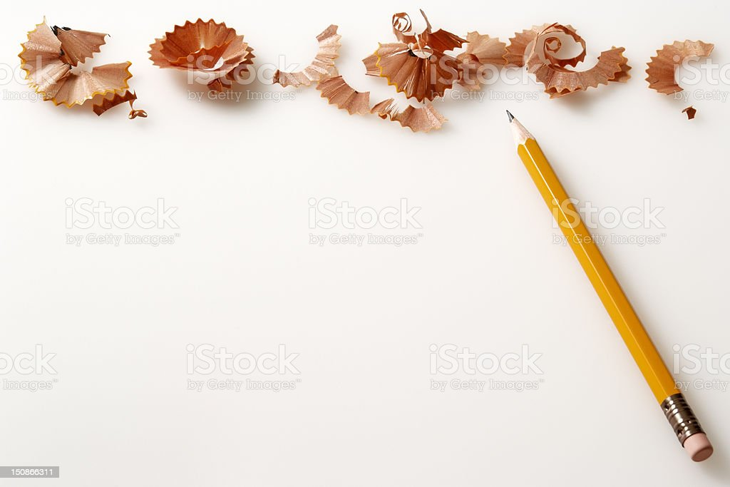Isolated shot of yellow pencil and shavings on white background stock photo