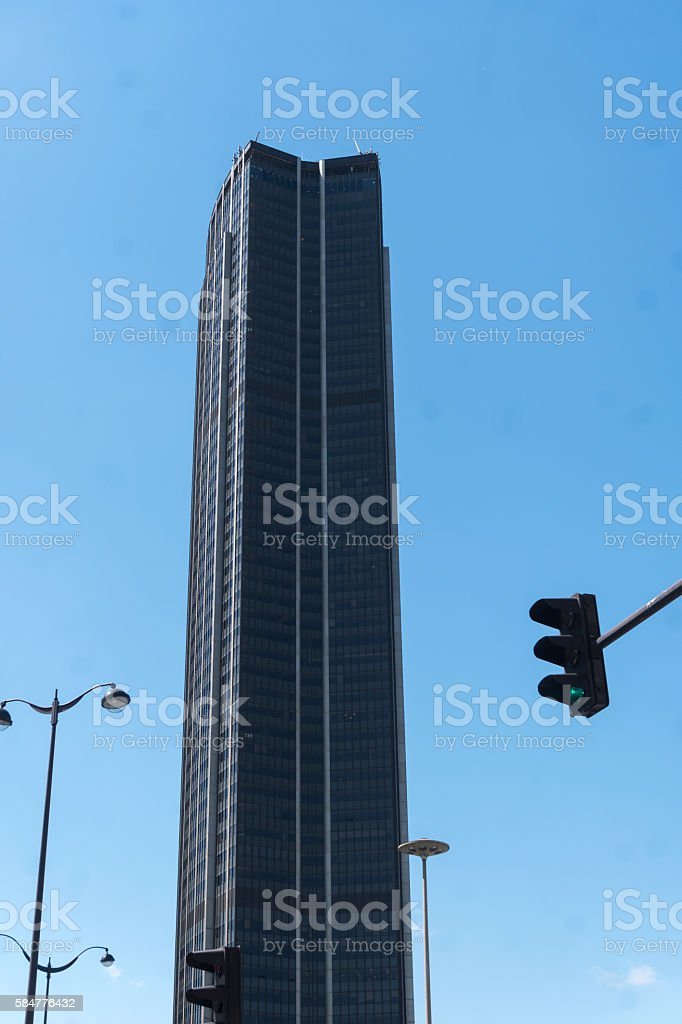 Isolated skyscraper against blue sky stock photo