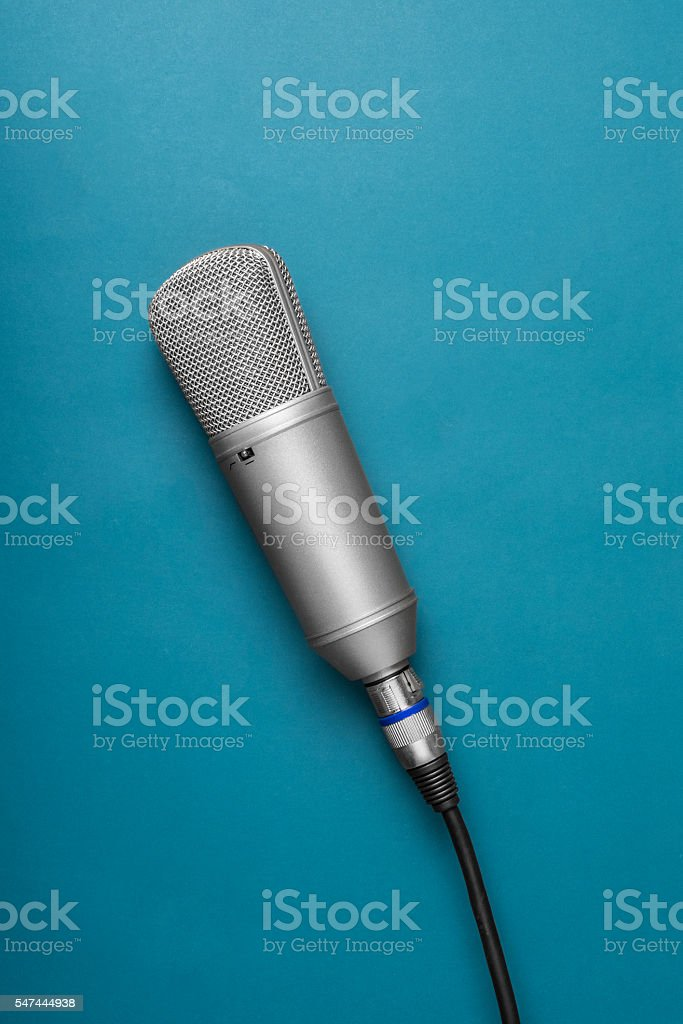 Isolated studio microphone on a grey background stock photo