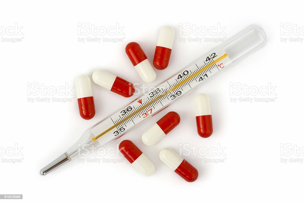 Isolated thermometer and pills royalty-free stock photo