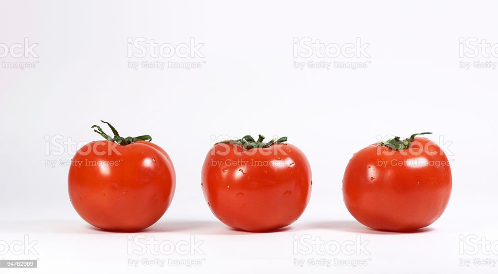 Isolated tomatoes on white background (sequence) royalty-free stock photo