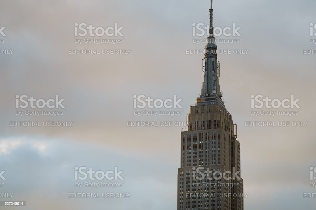 Isolated top of Empire State Building side lit at sunset stock photo